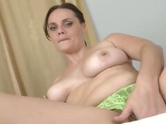 Amateur mom next door plays with her naturally big boobs and furry pussy before a self-induced orgasm with her fingers