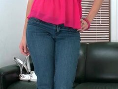 Well dressed redhead amateur strips solo