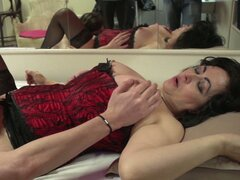 Redhead milf gets banged by young stud