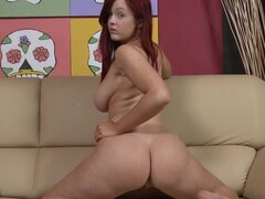Redhead and naughty teen Jaye Rose with natural big tits is posing her body on the sofa