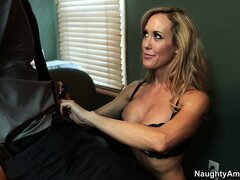 Brandi Love wraps her lips around his cock...
