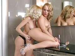 Two curly blonde lesbians fingering and licking pussies in toilet