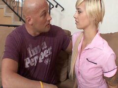 Bald guy samples a blonde girl with tattooes on his light brown sofa
