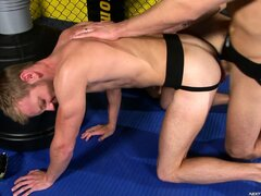 The winner takes his sparing partner's cum deep inside his ass