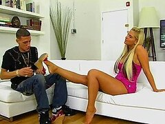 A sexy blonde pleases her boyfriend with a stunning footjob