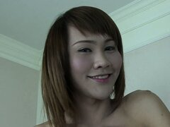 Skinny ladyboy June has got a yummy nice-sized gift hiding in her panties