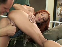 Hardcore redhead beauty is getting fucked by three dicks