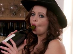 Busty brunette with a bottle of vine