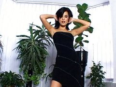 Nelly in elegaant and sensual black dress