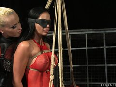 Kathia strings up her slave, blindfolds her and whacks her ass
