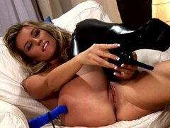 Blonde in black boots is showing her shaved kitty