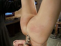 Long legged blonde is hung upside down, choked, clamped and abused