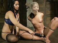 Skinny babe Skin Diamond is bound with brutal black rubber bands and made to squirt & suck cock
