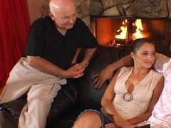 A dreamy dark haired doll gets two creepy cocks to play with by the fire