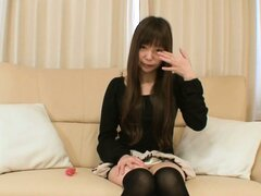 Sexy young Asian chick Tsukasa giggles shyly and shows off her sexy lingerie