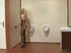 Tiffany Six and her huge Hungarian tits are horny as hell and she's not leaving this bathroom until she's nice and satisfied! Discovering a gloryhole with a cock sticking out of it she knows she's back on track, and this fishnet wrapped babe gets on her k