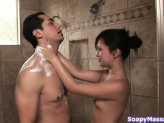 Asian uses her dainty feet to give her man a footjob in the bath