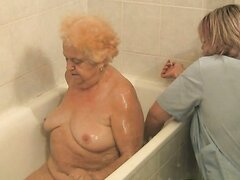 Sexy blonde granny Hermine gets her fat body washed by mature nurse