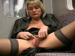 Horny blonde masturbates and sucks cock in train