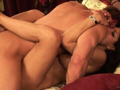 The magnificent cougar lies on the bed and has him pounding her snatch hard and deep