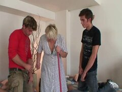 Old blonde cleaning woman is banged by two dudes