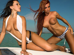 Two girls naked on boat