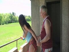 Young brunette gets hammered by old man on the balcony