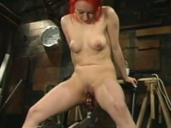 Redheaded bitch get fucked by fucking machine in her wet pussy