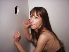 Gloryhole stockings whore gets a cumshot