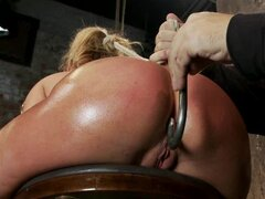Hogtied babe Charisma Capelli has her ass hooked