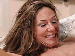 Brunette sweet MILF plays with young guy. Tasty video