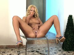 Blondie gets down and dirty in a solo and plays in her piss puddle on the chair
