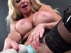 Taylor Wane is a sexy MILF wearing fishnets and thigh high boots