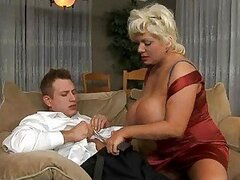 Busty momma Claudia Marie around huge cock and gives it a jerking