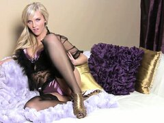 Stunning blonde in pantyhosed slim legs strips her underwear, lies back and enjoys herself