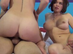 Threesome action with two young and busty brunettes