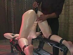 Redhead Fucked and Tortured in Interracial BDSM