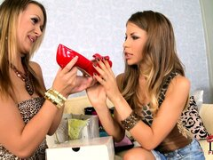 Lesbian babes in stilettos compare their shoes and lick some ass