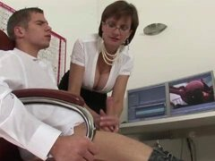 Lady Sonia lends a handjob to nasty femdom fetish cock as he watches porn