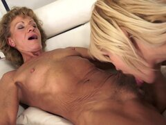 Blonde granny is fucking in puss of this young lesbian