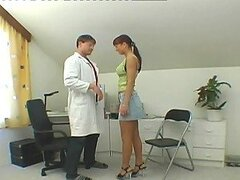 Naughty brunette tempts a doctor and fucks him on the floor