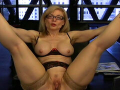 Mature solo girl stimulates trimmed pussy