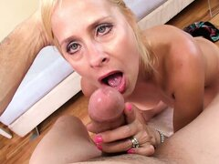 Seductive blonde milf with amazing natural tits displays her blowjob abilities