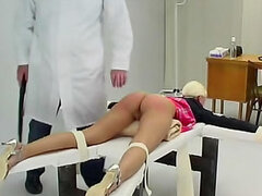 Doctor spanks ass of bound schoolgirl