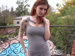 Cute tattooed redhead taking the Monster!
