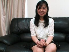 Sultry Asian cougar with a cute smile drops her clothes, eager to satisfy her desires