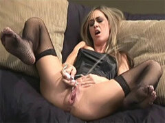 Sexy blonde milf fucks her shaved pussy with a sex toy until squirting