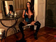 Busty blue latex dominatrix delivers a steamy solo strip show