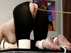 Naughty girl gets punished with a stick and some hot candle wax
