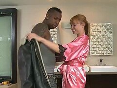 Redhead Babe Gives an Oily Massage to a Big Black Cock